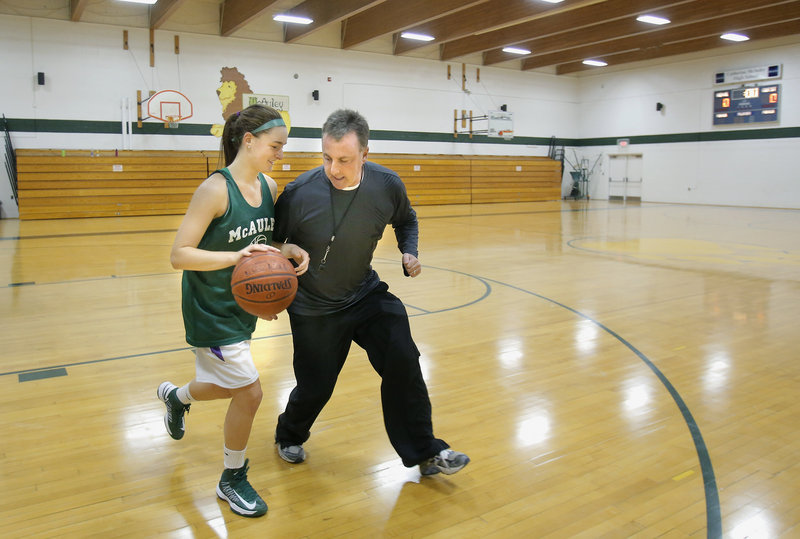 Allie Clement, one of the fastest players in the state, tries to get past Coach Bill Goodman as McAuley High School readies to defend its state championship.