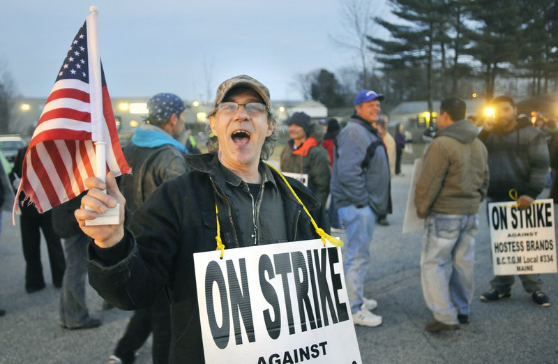 Tony Garland of Limington, who has worked at the Hostess Brands bakery in Biddeford for 28 years, marches on strike last week. Bakers' union members agreed to meet with Hostess representatives Tuesday at the urging of a bankruptcy judge in New York.