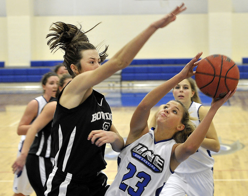 Alanna Vose, a University of New England freshman from Medomak Valley High, attempts to get her shot over Shannon Brady of Bowdoin during UNE's 72-32 victory Tuesday night. UNE had lost 17 straight to the Polar Bears.