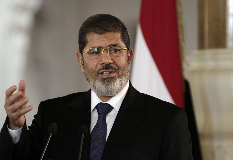 Egyptian President Mohammed Morsi has been thrust into the spotlight as his Islamist government performs a difficult balancing act of appeasing militants and the United States.