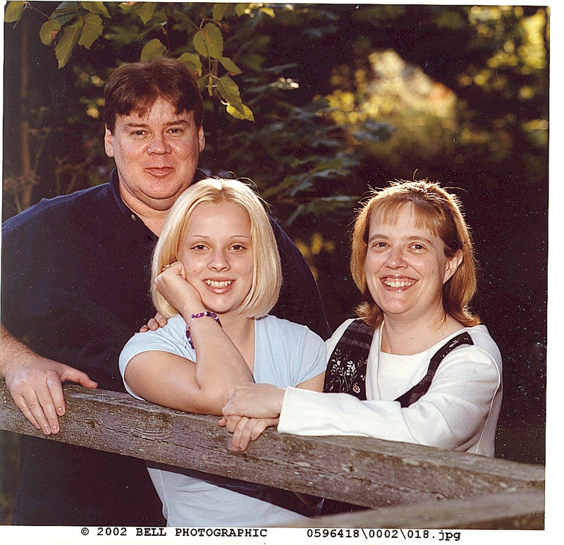 Samantha Folsom, center, appears with her parents, Jon and Joline Turner, in this 2002 photo.