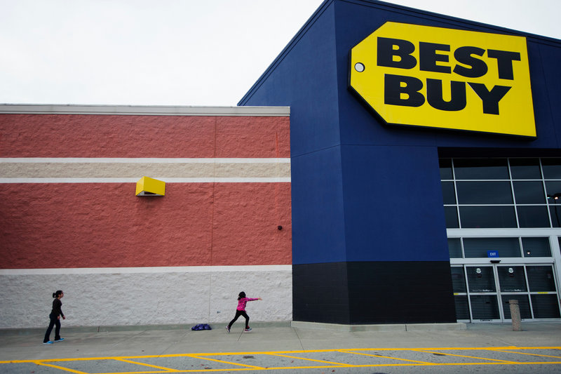 Children take a break Thursday from waiting in line at Best Buy in Carbondale, Ill. Richard Schulze, a former executive, is expected to offer as much as $8 billion to buy the company. His message is simple: His team created Best Buy – and only they can save it.