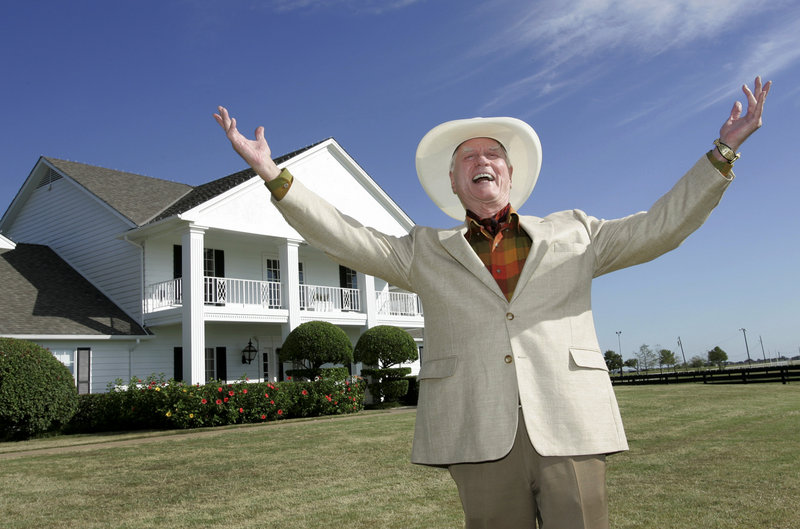 "Actor Larry Hagman poses in 2008 in front of the Southfork Ranch mansion in Parker, Texas, made famous in the hugely successful nighttime soap ""Dallas."" He died Friday of cancer."