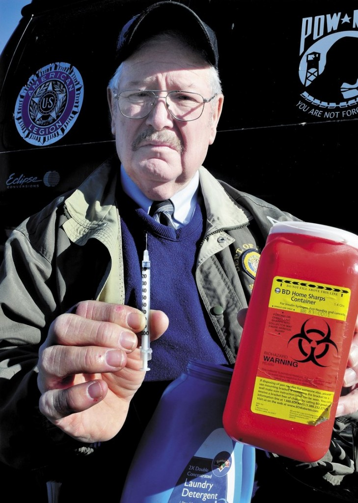 Don Simoneau of Fayette advocates for patients to use approved containers, like the one he is holding, when disposing of needles.