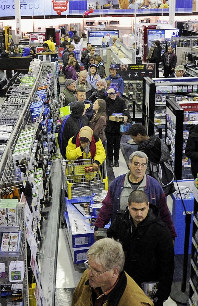 Black Friday shoppers wait in line just after midnight at the Best Buy store in the Maine Mall in South Portland.