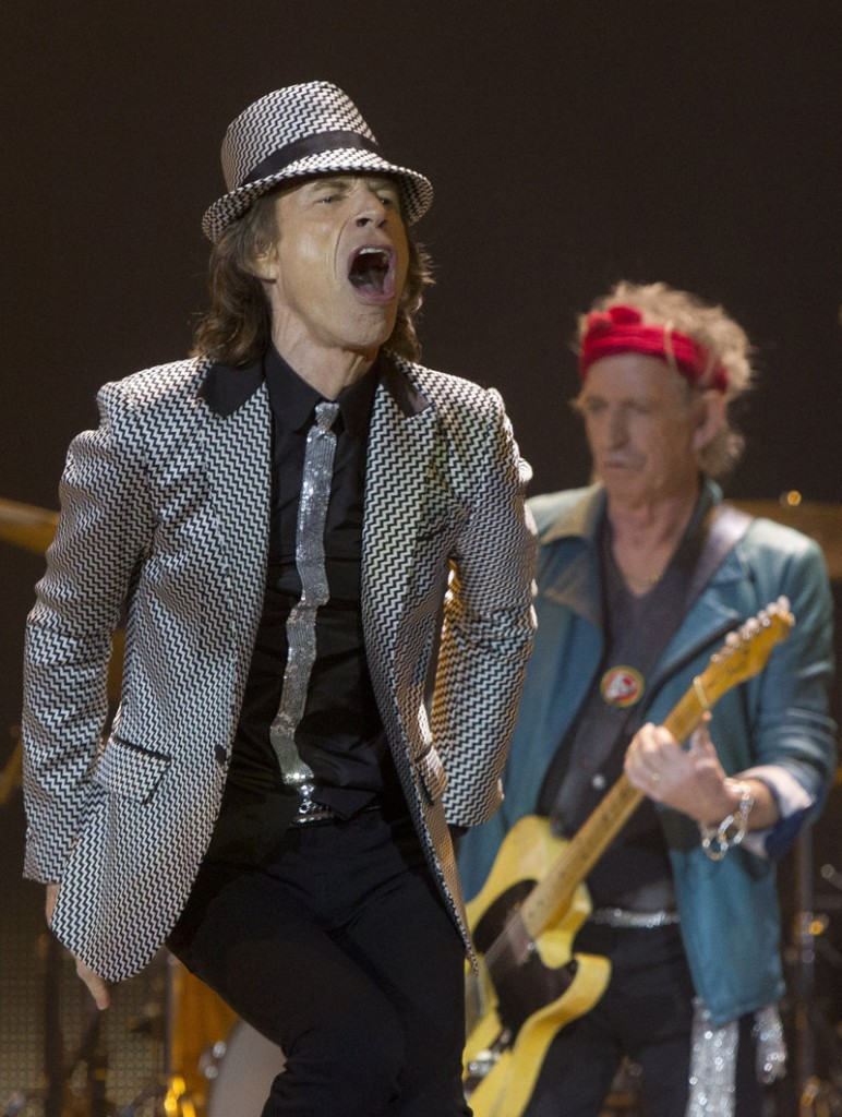 Mick Jagger, left, and Keith Richards of The Rolling Stones perform Sunday at the O2 Arena in London. The Stones are celebrating their 50th anniversary.