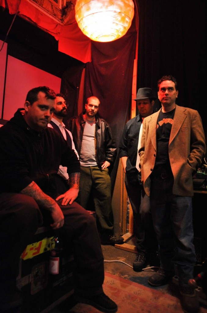 Johnny Cremains includes vocalist and theramin player Sean Libby, piano and organ player Erik Winter, drummer Michael Anderson, guitarist Doug Porter and bass player David Joy.