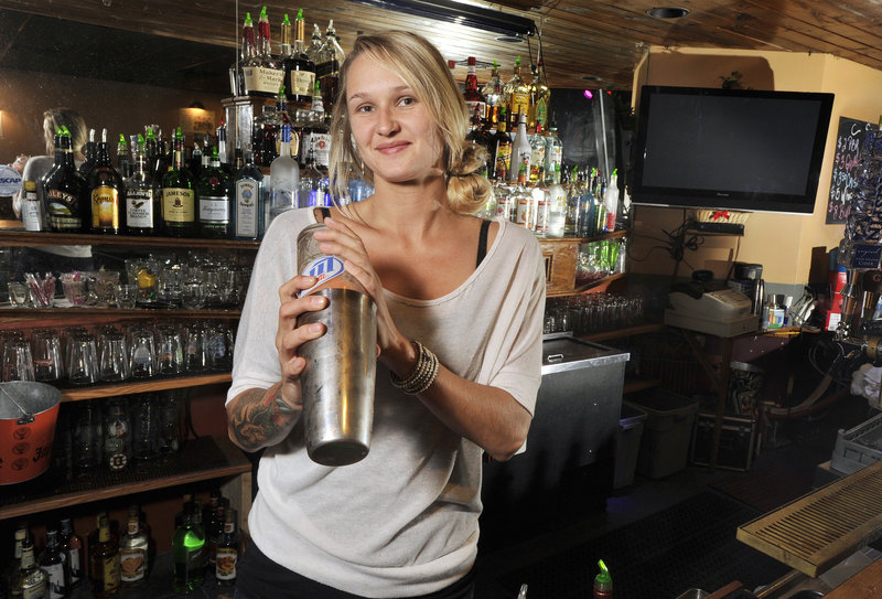 Erin Compton, bartender at The Big Easy in Portland, makes up a SoCo Hurricane, one of the bar's more popular drinks.