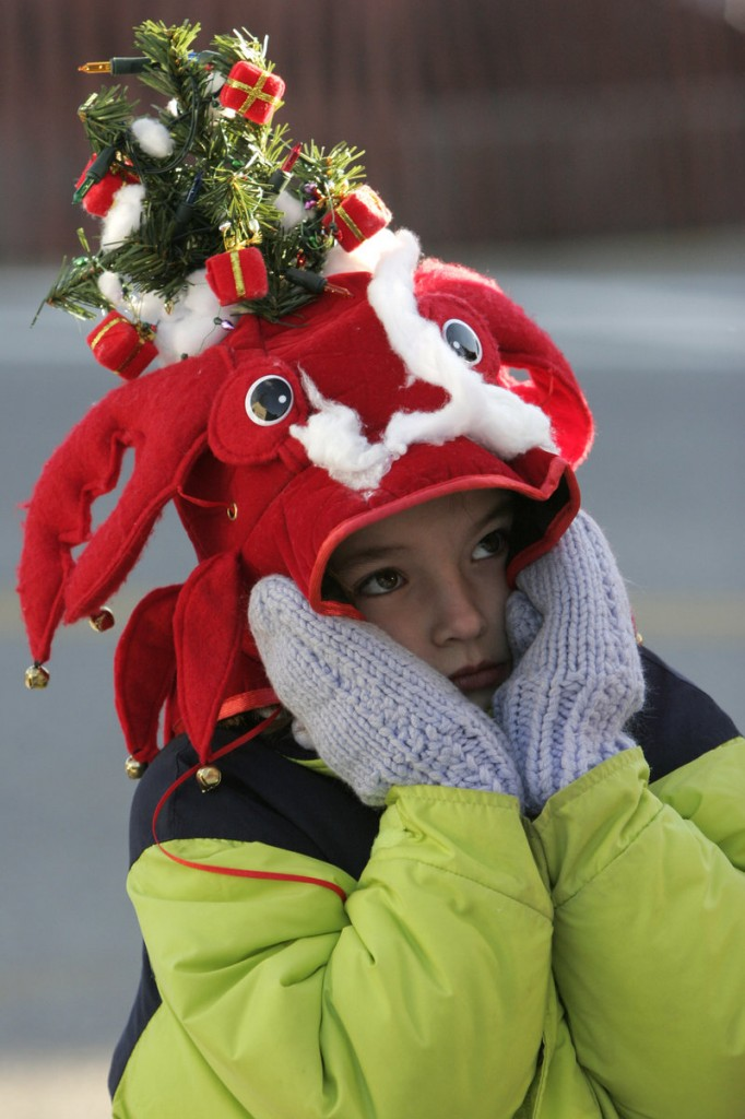 ... a youngster waiting for the Hat Parade to begin ...