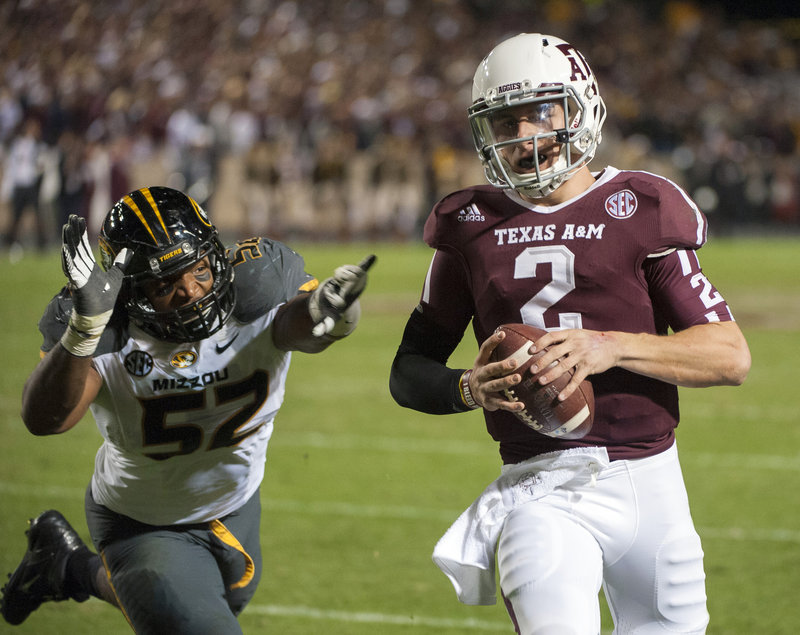 "Johnny Manziel of Texas A&M, shown evading Missouri's Michael Sam during last weekend's 59-29 victory, could soon be the first freshman – albeit not a ""true"" one – to win the coveted Heisman Trophy."