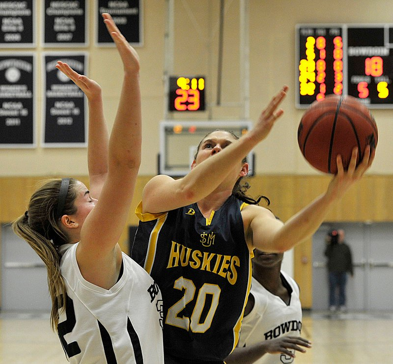 Rebecca Knight, who scored 25 points for USM, including 21 in the second half, puts up a shot over Megan Phelps of Bowdoin.