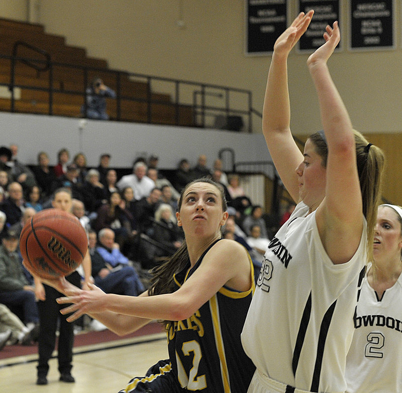USM has played five games and won them all, adding Bowdoin to its list of opponents after a victory Sunday against St. Joseph's. Erin McNamara of the Huskies drives to the basket.