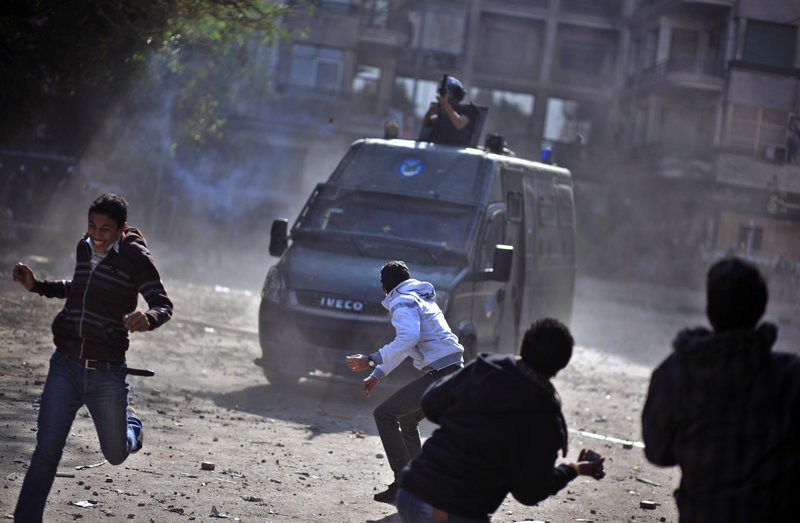 Egyptian protesters clash with security forces Wednesday near Tahrir Square in Cairo. Judges in Egypt's top courts are protesting the president's seizure of near absolute powers.