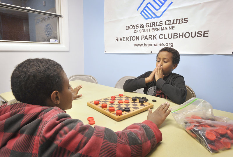 Abdibasil Hassan, left, and Abdihakim Ukash play a game of checkers at the Riverton Park Clubhouse on Thursday, Nov. 29, 2012. The Boys & Girls Club of Southern Maine, in partnership with the Portland Housing Authority, have just completed a $180,000 expansion to the club to allow for more children.