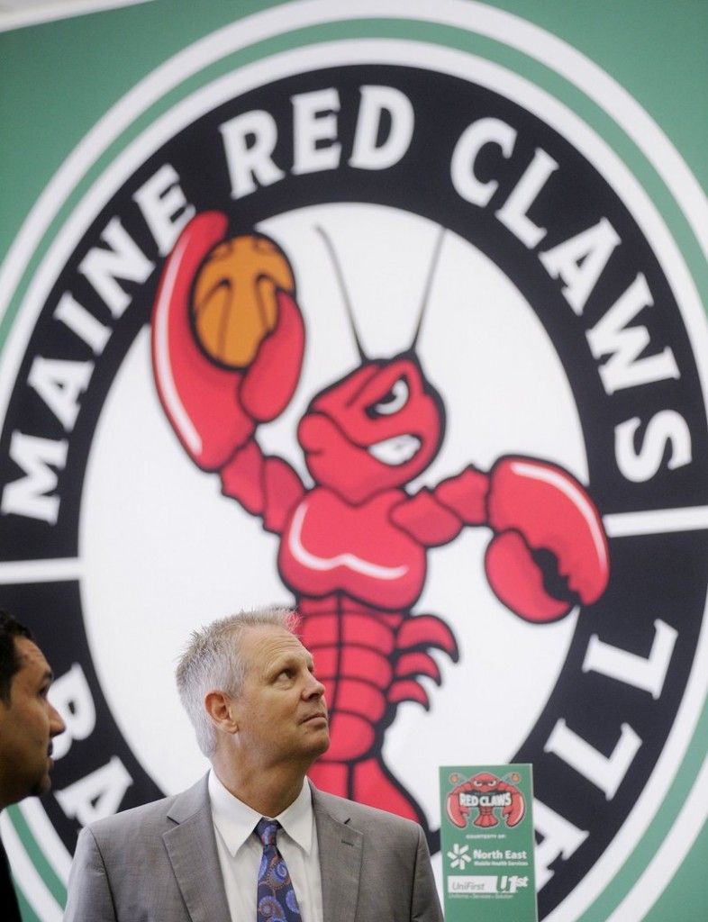 Danny Ainge, president of basketball operations for the Boston Celtics, visits the Maine Red Claws front office last June in Portland. Under a new single-affiliation agreement, the Celtics run basketball operations for Maine's team.