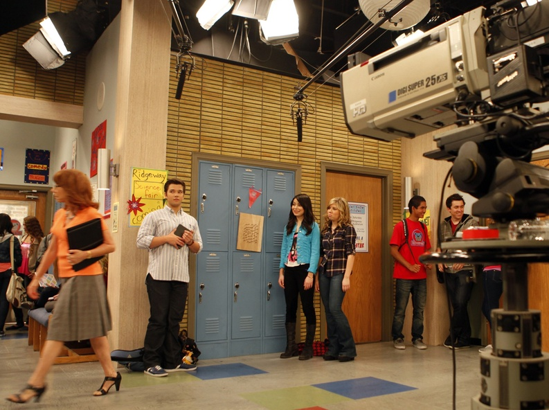 "Miranda Cosgrove, center, as ""Carly Shay"" with Jennette McCurdy, next to Cosgrove, as ""Sam Puckett"", Nathan Kress, center left, as ""Freddie Benson"" and Mindy Sterling, left, playing teacher ""Mrs. Briggs"" work on the set of ""iCarly,"" in Hollywood last June."