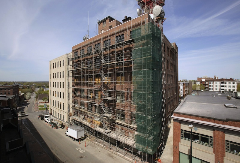 In this 2011 file photo, the central office building for FairPoint Communications at the corner of Cumberland Avenue and Forest Avenue in Portland undergoes a multimillion-dollar renovation. FairPoint Communications, which provides telephone and Internet services, said on Friday it laid off 29 workers, mostly in Maine and New Hampshire.