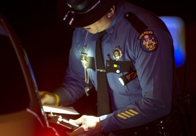 Maine State Police Trooper Doug Cropper talks with a motor vehicle operator after pulling him over for speeding on I-295, in this December 2011 photo.