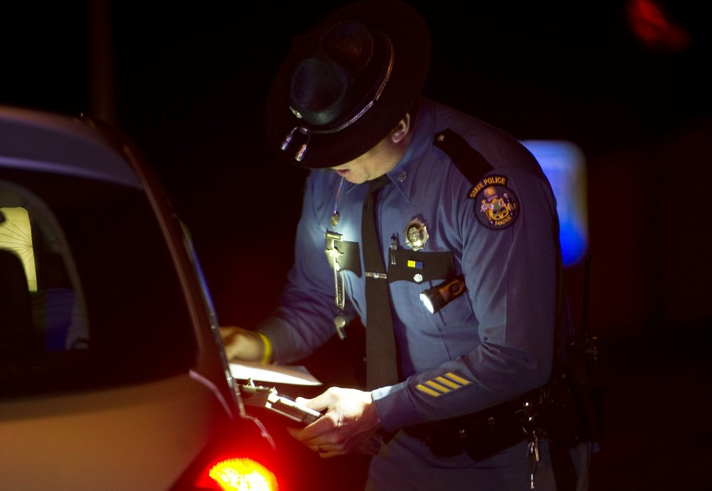 File photo: Maine State Police Trooper Doug Cropper talks with a motor vehicle operator after pulling him over for speeding on I-295, Thursday, December 15, 2011.