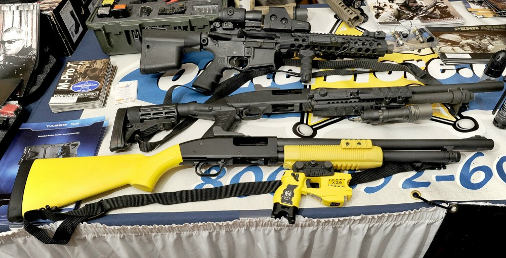 Thursday, Feb.2, 2012. A Taser X-12 at bottom among conventional shotguns above on display as the Maine Chiefs of Police Association winter meeting and trade show in South Portland.