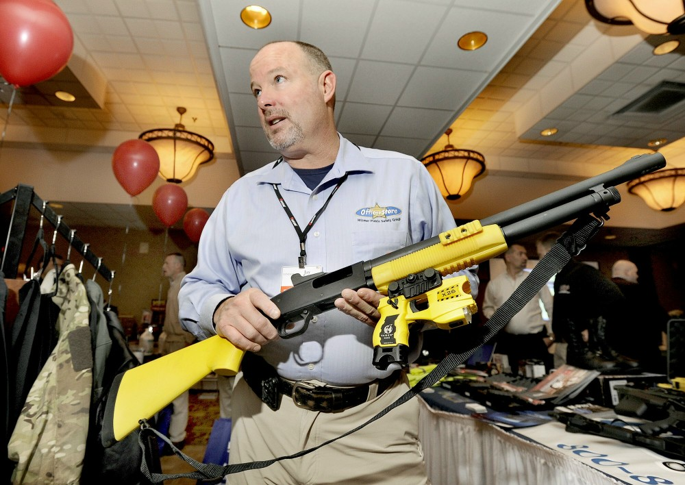 Thursday, Feb.2, 2012. Jay Kehoe demonstrates a new non-lethal weapon called a Taser X-12 at the Maine Chiefs of Police Association winter meeting and trade show in South Portland.