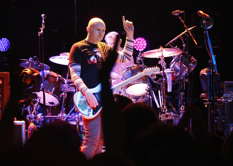 Smashing Pumpkins lead singer Billy Corgan signals to the crowd during the band's opening set Saturday at the State Theatre.
