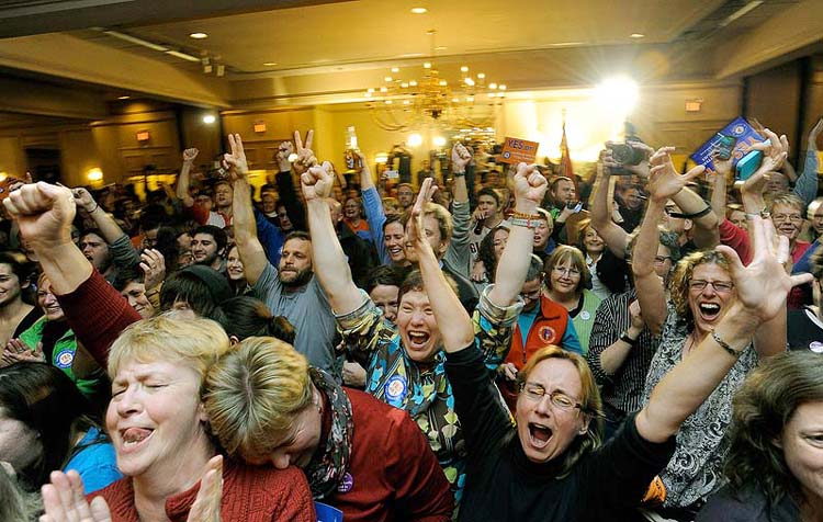 People celebrate after learning same sex marriage had passed at the Mainers United for Marriage party at the Holiday Inn by the Bay Tuesday, November 6, 2012. The city of Portland will open City Hall at midnight Dec. 29 to give out marriage license and perform the first same-sex weddings in the state.