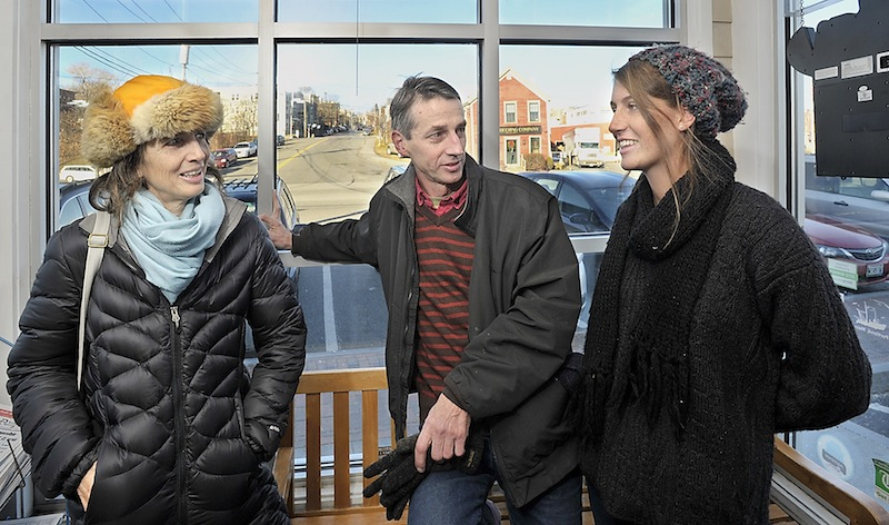 """On Wednesday, Dec. 12, 2012, Mainers answer the question, """"Do you think the world will end on December 21?"""" Cornelia Walworth, left, Mark McCain and his daughter, Chase McCain, respond in different ways in the foyer of Becky's Diner in Portland."""