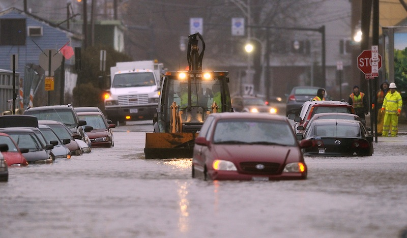 A bucketloader approaches a submerged van on Somerset Street in Portland Wednesday, December 19, 2012, after a water main break caused flooding through much of the area.