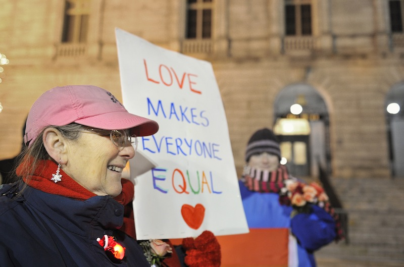 Gail Berenson of Portland holds a sign in support of same-sex marriage outside Portland City Hall Friday, December 28, 2012, before the first same sex marriages in Maine were performed. Berenson was part of a group that demonstrated in front of the Cathedral for the past three years.