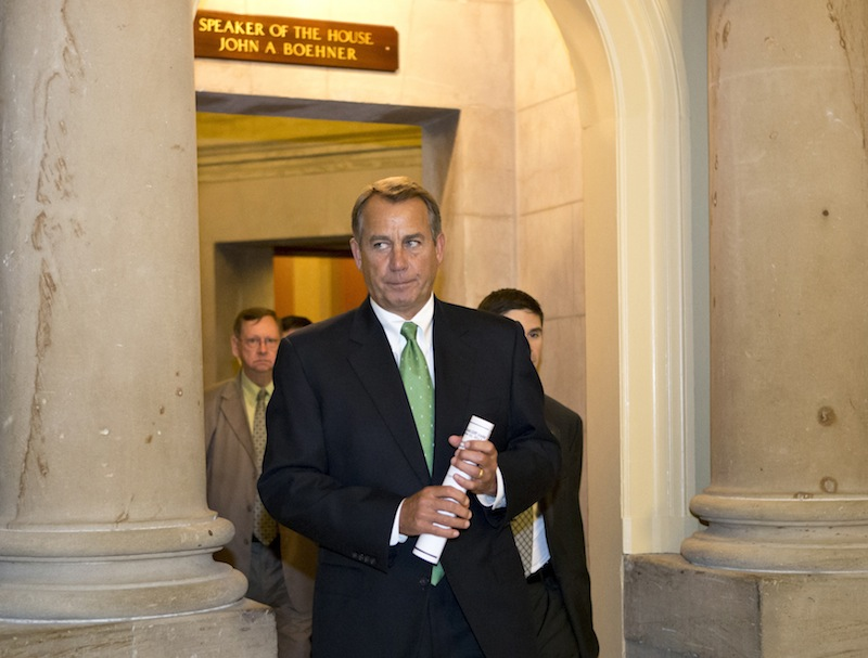 House Speaker John Boehner of Ohio leaves his office and walks to the House floor to deliver remarks about negotiations with President Obama on the fiscal cliff, Tuesday, Dec. 11, 2012, on Capitol Hill in Washington. (AP Photo/J. Scott Applewhite)