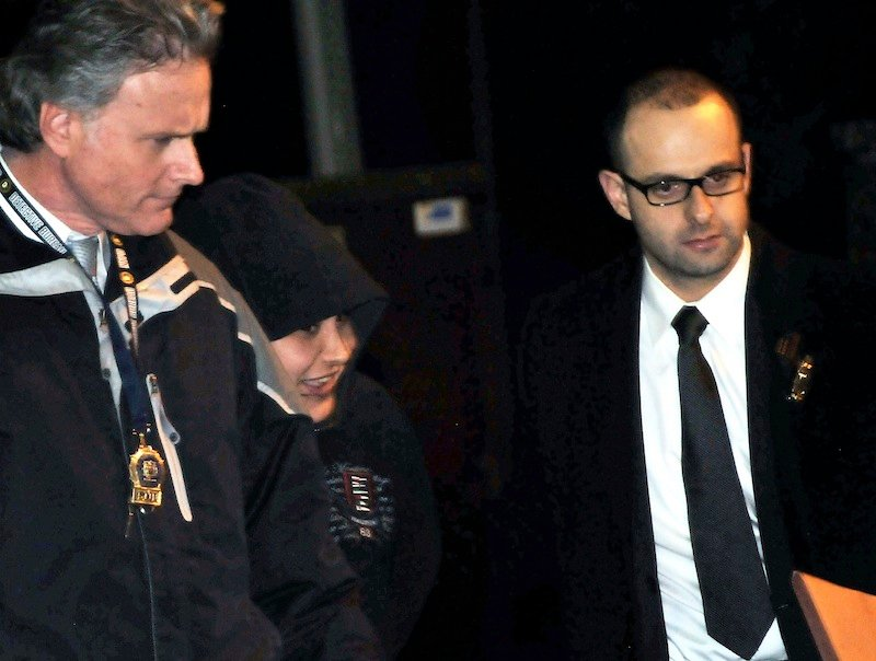 In this Saturday, Dec. 29, 2012 photo, New York City Police Department detectives escort Erika Menendez, second from left, out of the 112th Precinct in the Queens borough of New York. Menendez was arraigned Saturday night on a charge of murder as a hate crime. Judge Gia Morris has ordered that the 31-year-old be held without bail and be given a mental health exam. (AP Photo/Newsday, Danielle Finkelstein)