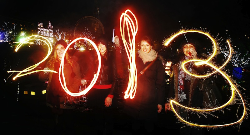 Katy Saunders, left, Alex Mueller, center left, Rebekka Frank and Arina Motamedi, right, play with sparklers ahead of welcoming in the new year during the 2013 Edinburgh Hogmanay celebrations, Scotland, Monday December 31, 2012. See PA story SOCIAL NewYear. (AP Photo/PA,Danny Lawson)