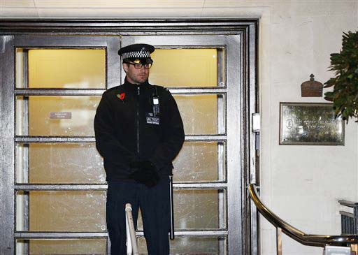 A policeman stands guard outside the King Edward VII hospital, in central London on Friday.