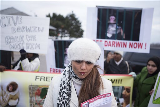 """Yasmin Nakhuda stands with supporters outside an Animal Services offices in Toronto on Wednesday to rally support for the return of her monkey, """"Darwin."""""""