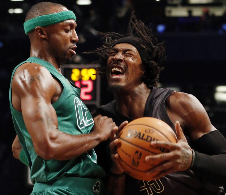 Gerald Wallace of the Brooklyn Nets charges into Jason Terry of the Boston Celtics during the first half of their Christmas game Tuesday. Boston beat the Nets for the first time in three meetings this season, 93-76.