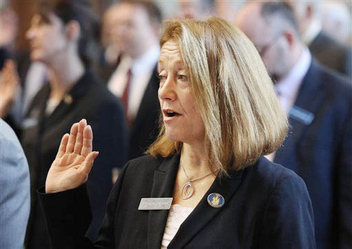 Rep. Kathleen Chase, of Wells, is sworn in Wednesday at the State House in Augusta.