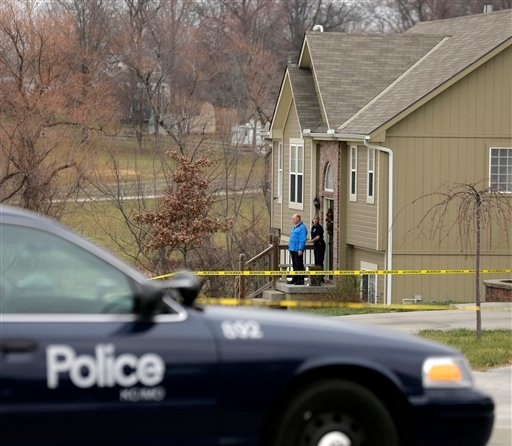 Investigators stand outside an Independence, Mo., house where police say Kansas City Chiefs linebacker Jovan Belcher fatally shot his girlfriend Saturday before driving to the NFL football team's training facility and shooting himself.