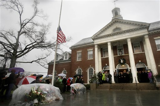 Officials including Connecticut Gov. Dan Malloy observe a moment of silence on the steps of Edmond Town Hall while bells ring 26 times in Newtown, Conn., on Friday.
