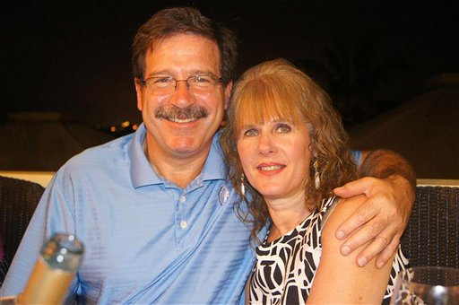 In an undated image provided by Mark Sherlach, Sherlach and his wife, school psychologist Mary Sherlach, pose for a photo. Mary Sherlach was killed Friday when she and principal Dawn Hochsprung, below, confronted a gunman who opened fire at Sandy Hook Elementary School in Newtown, Conn., killing 26 people.