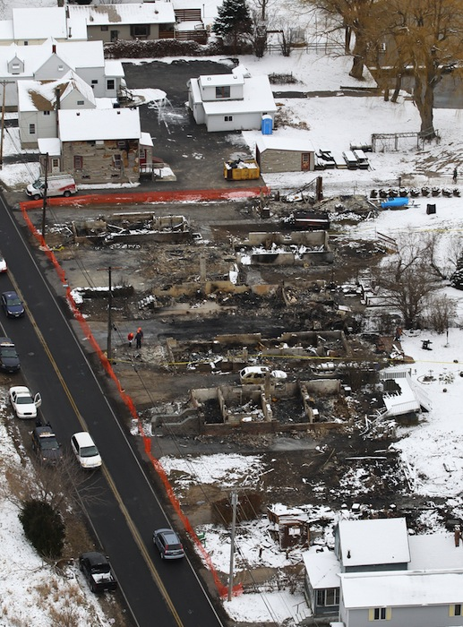 An aerial view of Lake Road in Webster where Williams Spengler set his house on fire then waited to shoot firefighters as they arrived to extinguish it. He killed two firefighters and injured two others. Spengler shot and killed himself. The fire consumed seven houses.