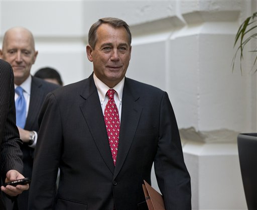 """Speaker of the House John Boehner, R-Ohio, arrives for a closed-door meeting with House Republicans as he negotiates with President Obama to avert the fiscal cliff, at the Capitol in Washington, Tuesday, Dec. 18, 2012. More than 7,000 Maine residents could be among the first Americans to fall off the """"fiscal cliff"""" unless Democrats and Republicans on Capitol Hill agree to extend unemployment benefits for 2 million Americans who have been out of work for six months or longer. (AP Photo/J. Scott Applewhite)"""