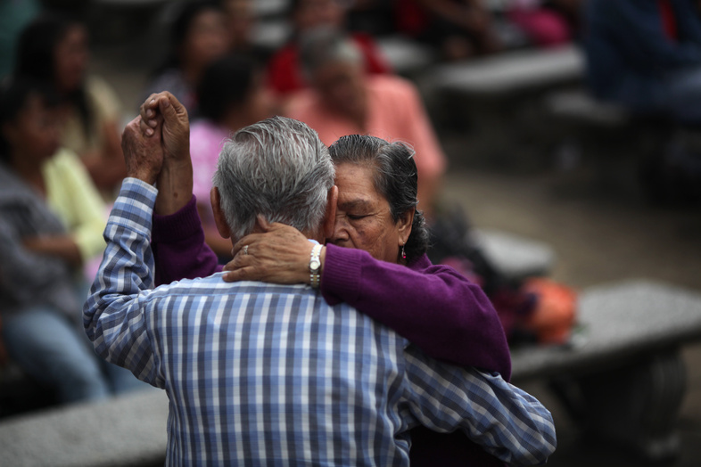 "A couple dances in a park in Guatemala City – a country with a ""culture of friendly people who are always smiling,"" said surfing instructor Luz Castillo."
