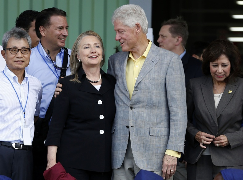 Former President Bill Clinton, his wife Secretary of State Hillary Rodham Clinton and Labor Secretary Hilda Solis, right, attend the grand opening ceremony of the new Caracol Industrial Park in Caracol, Haiti, Monday, Oct, 22, 2012. Martin Scorsese has found his next film subject: Bill Clinton. (AP Photo/Larry Downing, Pool)