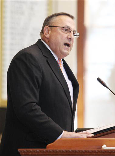Gov. Paul LePage speaks Wednesday at the swearing in ceremony for new representatives at the State House. LePage administered the oath of office to the new legislators who were elected last month.