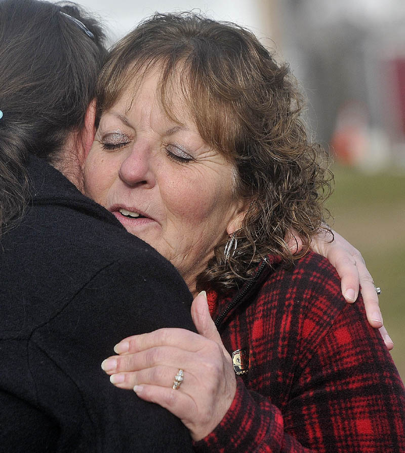 Christine Belangia, right, hugs Laurie Ann Robbins, left, following the sentencing of Jay Mercier at the Somerset County Superior Court House in Skowhegan on Friday.