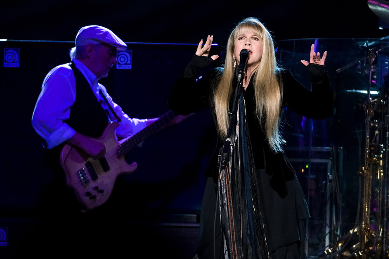 John McVie, left, and Stevie Nicks of Fleetwood Mac performat Madison Square Garden in New York in 2009. Fleetwood Mac is heading back on the road with a 34-city U.S. tour kicking off April 3, 2013, in Columbus, Ohio.