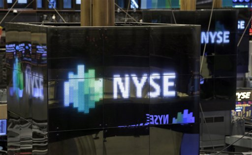 NYSE logos top trading posts on the floor of the New York Stock Exchange on Thursday.
