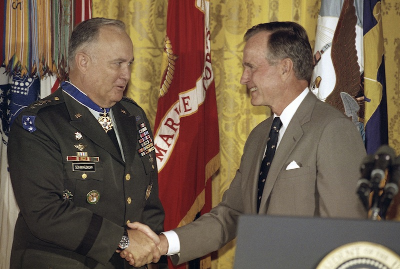 In this July 4, 1991, photo, President George Bush congratulates Gen. Norman Schwarzkopf after presenting him the medal of freedom at the White House in Washington. Schwarzkopf died Thursday in Tampa, Fla. He was 78.