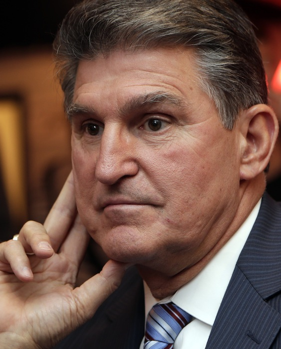 In this Nov. 6, 2012 file photo, Sen. Joe Manchin, D-WV., watches vote returns at his election watch party in Fairmont, W. Va. On Monday, Sen. Joe Manchin, a lifelong member of the National Rifle Association, said it was time to discuss gun policy and move toward action on gun regulation. (AP Photo/Dave Martin)